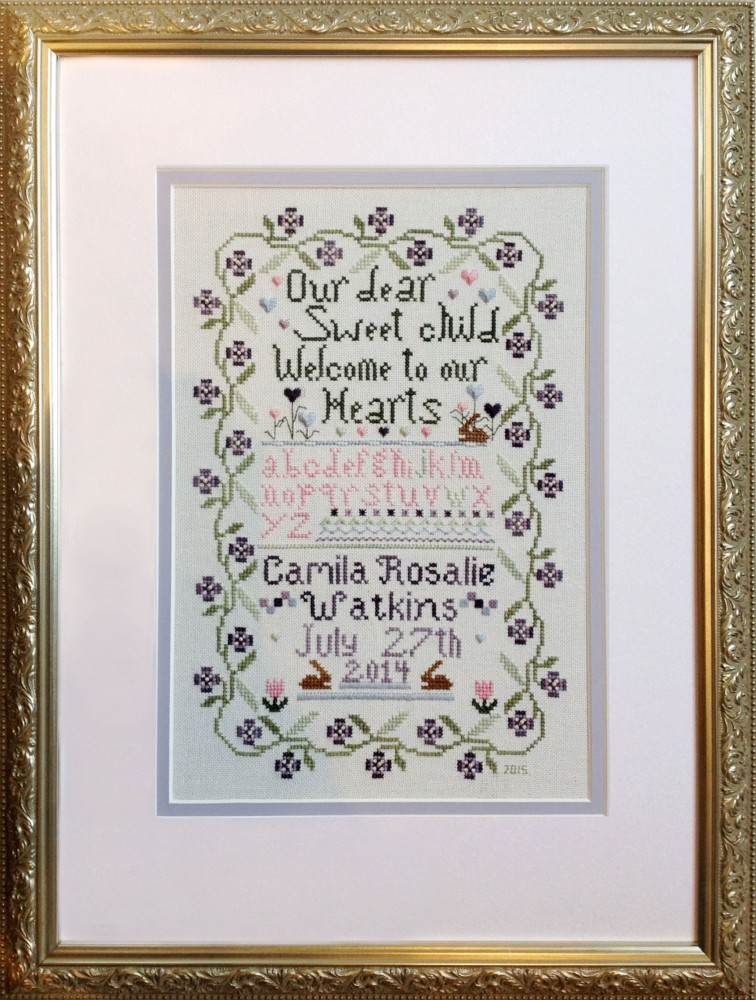 baby sampler in cross stitch