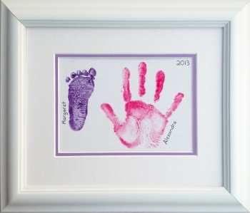 Framed hand and footprint.