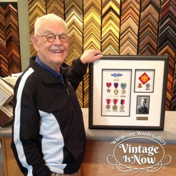 So proud! US Army WWII veteran showing his custom framed medals